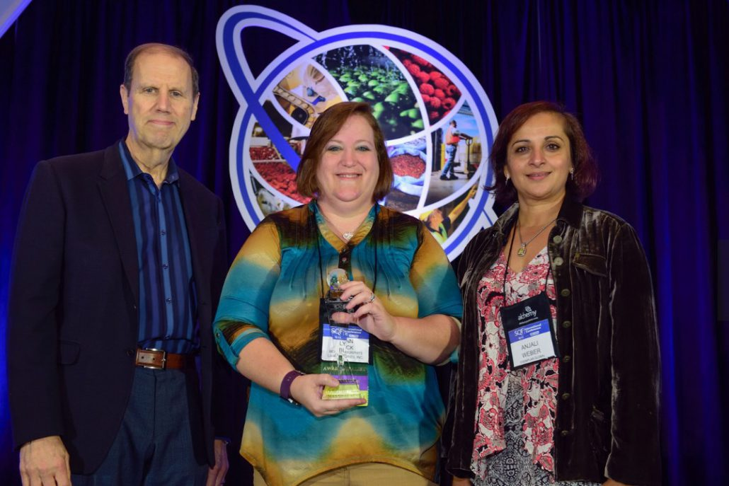 (L-R) Robert Garfield, SQFI, Senior Vice President, Lynn Buck, SQF Practitioner of the Year 2016, Anjali Weber, Vice President, Exemplar Global, Inc