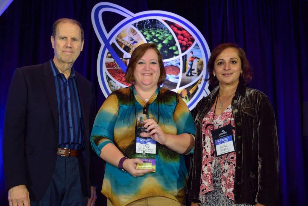 (L-R) Robert Garfield, SQFI, Senior Vice President, Lynn Buck, SQF Practitioner of the Year 2016, Anjali Weber, Vice President, Exemplar Global, Inc